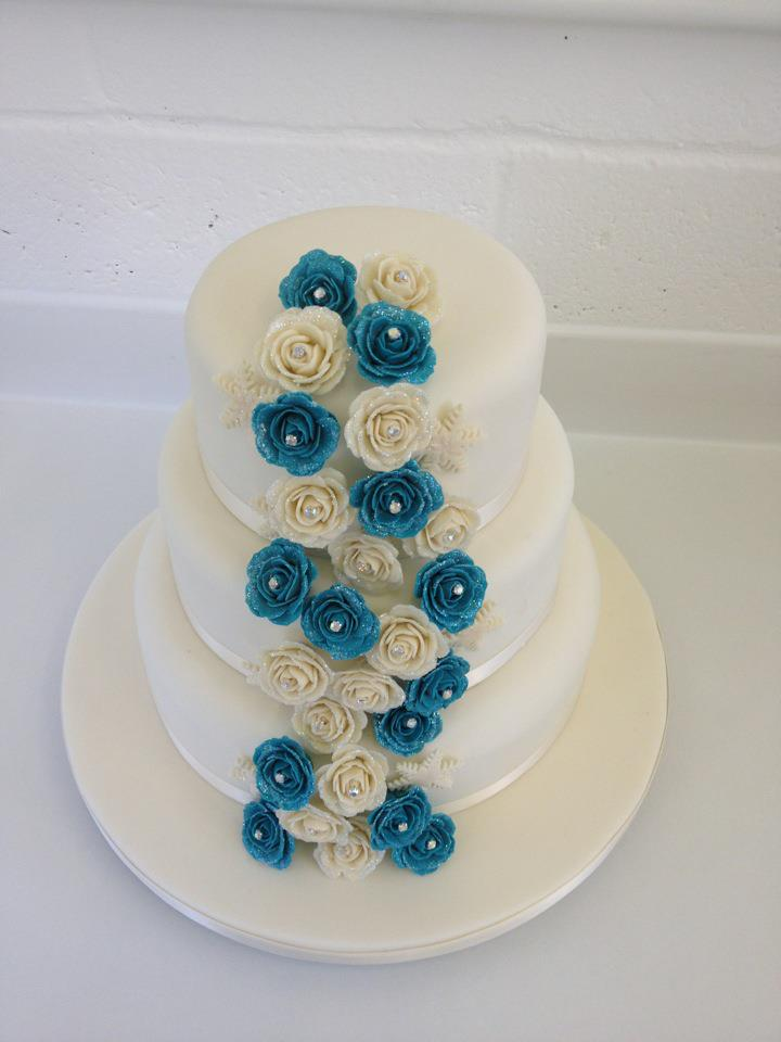 Three Tier Classic Wedding Cake, Cascading Ivory and Blue Roses