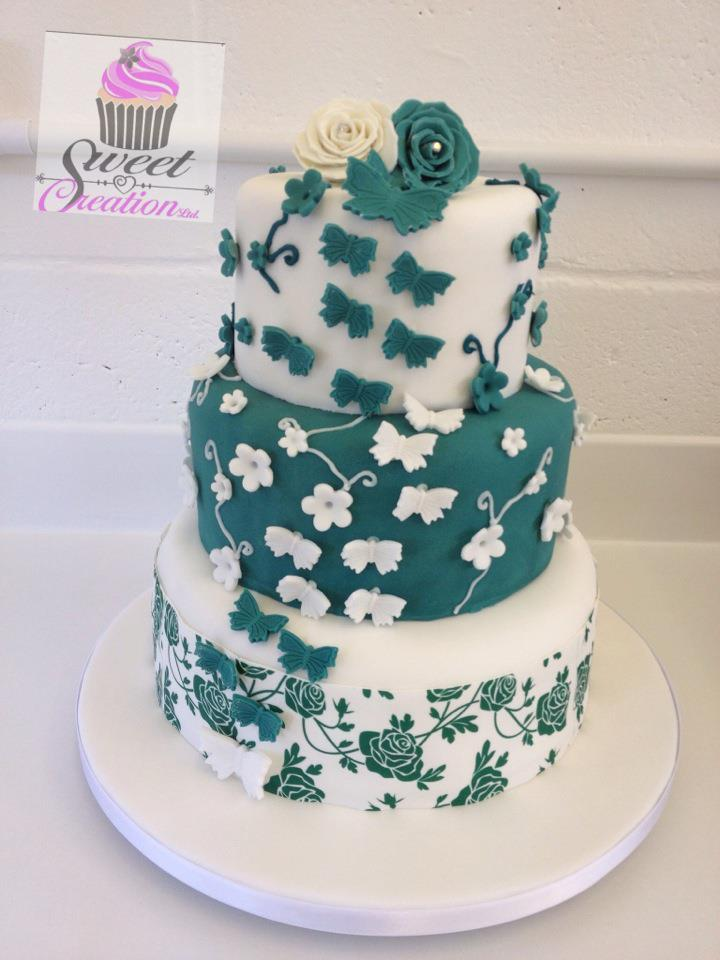 Classic Over-Sized Round american stacked wedding cake, with cascading Butterflies